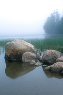 An early morning fog rests on Echo Lake in Acadia National Park.