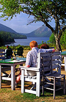 Diners at the Jordan Pond House Restaurant overlooking Jordan Pond